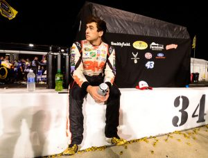 Chase Elliott sits on pit wall after Saturday's Federated Auto Parts 400 Robert Laberge/Getty Images North America photo).